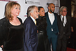 (L-R) Guest, Recording Academy President and CEO Neil Portnow, Alicia Keys and her husband Swizz Beatz, and guest arrivesat  the Recording Academy Producers & Engineers Wing event honoring Alicia Keys and Swizz Beatz at 30 Rockefeller Plaza in New York City, during Grammy Week on January 25, 2018.