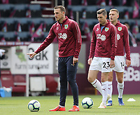 (from left) Burnley's Chris Wood, Stephen Ward and Ben Gibson during the pre-match warm-up <br /> <br /> Photographer Rich Linley/CameraSport<br /> <br /> The Premier League - Saturday 13th April 2019 - Burnley v Cardiff City - Turf Moor - Burnley<br /> <br /> World Copyright © 2019 CameraSport. All rights reserved. 43 Linden Ave. Countesthorpe. Leicester. England. LE8 5PG - Tel: +44 (0) 116 277 4147 - admin@camerasport.com - www.camerasport.com