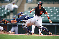 GCL Rays catcher Samm Wiggins (39) dives attempting to tag a sliding base runner during the second game of a doubleheader against the GCL Orioles on August 1, 2015 at the Ed Smith Stadium in Sarasota, Florida.  GCL Orioles defeated the GCL Rays 11-4.  (Mike Janes/Four Seam Images)