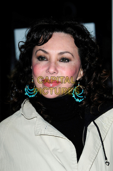 MARIE HELVIN.An Academy Tribute To Jeremy Thomas,.Curzon Soho,Shaftesbury Avenue, London, England..November 25th 2010.headshot portrait black white green earrings lips plastic surgery.CAP/CAS.©Bob Cass/Capital Pictures.