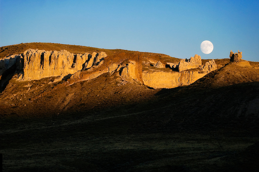 The moon rises over the White Cliffs sections of the Missouri River in central Montana.