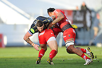 Matt Banahan of Bath Rugby is double-tackled. European Rugby Champions Cup match, between RC Toulon and Bath Rugby on January 10, 2016 at the Stade Mayol in Toulon, France. Photo by: Patrick Khachfe / Onside Images
