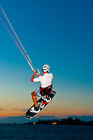 Kite surfing at sunset, Plage du Meridien (Anse Vata), Noumea, Grand Terre, New Caledonia