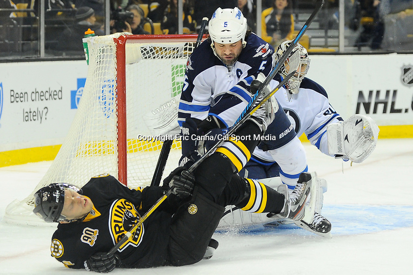 January 2, 2014 - Boston, Massachusetts, U.S. - Boston Bruins center Carl Soderberg (34) is hit by Winnipeg Jets defenseman Mark Stuart (5) at the net during the NHL game between Winnipeg Jets and the Boston Bruins held at TD Garden in Boston Massachusetts.  Boston defeated Winnipeg 4-1 in regulation. Eric Canha/CSM