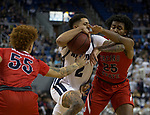 Nevada  guard Jalen Harris (2) is fouled as he drives past the Fresno State defense during the first half of a basketball game played at Lawlor Events Center in Reno, Nev., Saturday, Feb. 22, 2020.
