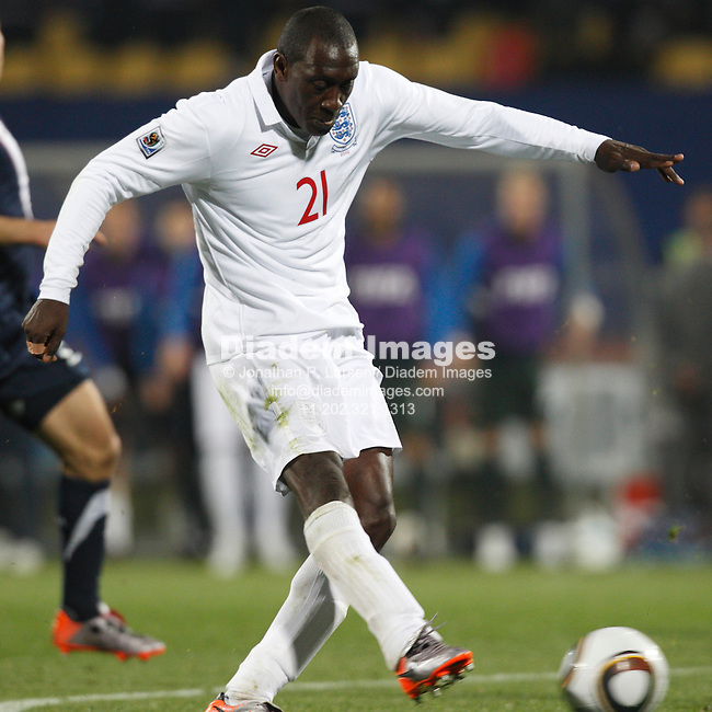 RUSTENBURG, SOUTH AFRICA - JUNE 12:  Emile Heskey of England strikes a shot against the United States during a 2010 FIFA World Cup soccer match June 12, 2010 in Rustenburg, South Africa.  NO mobile use.  Editorial ONLY.  (Photograph by Jonathan P. Larsen)