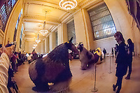 "Dancers in 30 colorful horse costumes perform ""Heard-NY"" by performance artist Nick Cave and choreographer William Gill in Vanderbilt Hall of Grand Central Terminal in New York on Tuesday, March 26, 2013. The costumes made of fabric are each inhabited by two dancers from the Alvin Ailey School who meander around the hall like a herd of horses. Cave is known for his ""soundsuits"", costumes which are sculptures that make noise as the wearer moves about. The performances are twice a day at 11AM and 2PM until March 31. (© Frances M. Roberts)"