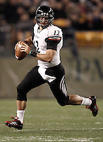 PITTSBURGH, PA - NOVEMBER 05:  Zach Collaros #12 of the Cincinnati Bearcats runs with the ball before throwing against the Pittsburgh Panthers on November 5, 2011 at Heinz Field in Pittsburgh, Pennsylvania.  (Photo by Jared Wickerham/Getty Images)
