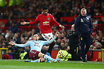 Frederic Guilbert of Aston Villa tackles Marcus Rashford of Manchester United during the Premier League match at Old Trafford, Manchester. Picture date: 1st December 2019. Picture credit should read: Phil Oldham/Sportimage