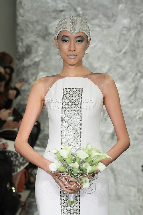 Model Shin Yang walks runway in Uhura - a white silk crepe bridal gown with silver quartz crystal panel, from the Theia Spring 2017 bridal collection by Don O'Neill, during New York Bridal Fashion Week Spring Summer 2017 on April 14, 2016.