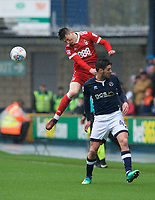 Joe Lolley of Nottingham Forest wins the header from Ben Marshall of Millwall during the Sky Bet Championship match between Millwall and Nottingham Forest at The Den, London, England on 30 March 2018. Photo by Alan  Stanford / PRiME Media Images.