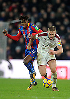 Crystal Palace's Wilfried Zaha battles with Burnley's Charlie Taylor<br /> <br /> Photographer Ashley Crowden/CameraSport<br /> <br /> The Premier League - Crystal Palace v Burnley - Saturday 13th January 2018 - Selhurst Park - London<br /> <br /> World Copyright &copy; 2018 CameraSport. All rights reserved. 43 Linden Ave. Countesthorpe. Leicester. England. LE8 5PG - Tel: +44 (0) 116 277 4147 - admin@camerasport.com - www.camerasport.com