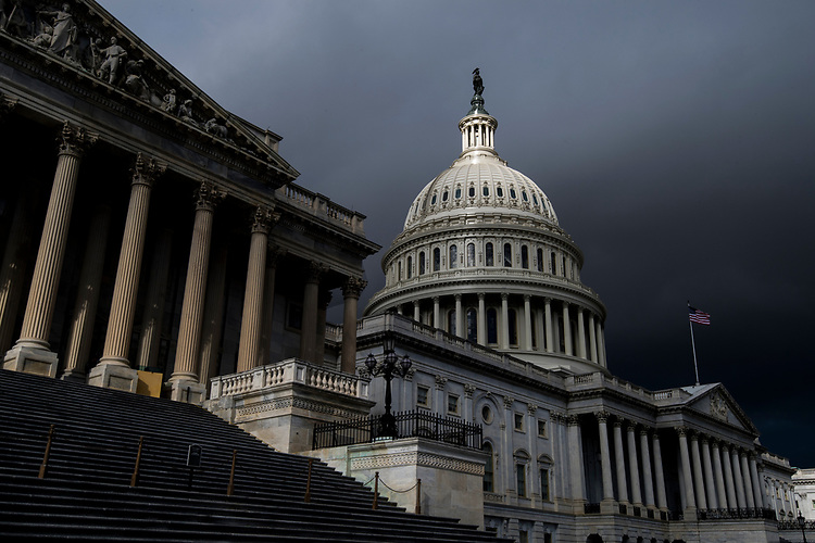 UNITED STATES - JANUARY 23: Storm clouds pass over the dome of the U.S. Capitol building on Tuesday, Jan. 23, 2018. (Photo By Bill Clark/CQ Roll Call)