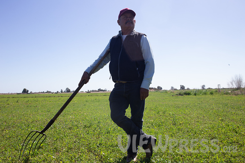 MEXICALI, MEXICO - March 13 . Miguel Angulo, a farmer from Baja California Mexico poses for a portrait with his Pitchfork on March 13, 2019 in Mexicali, Mexico.<br /> The rivers usually end in the sea, the Colorado dies in a border. Its the only case like this in the world. There is less water in the Colorado River, hence less water in crops and areas of northern Mexico.  <br /> (Photo by Luis Boza/VIEWpress)