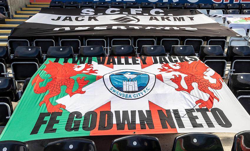 Supporters flags line the stands at the Liberty Stadium <br /> <br /> Photographer Andrew Kearns/CameraSport<br /> <br /> The EFL Sky Bet Championship - Swansea City v Leeds United - Sunday 12th July 2020 - Liberty Stadium - Swansea<br /> <br /> World Copyright © 2020 CameraSport. All rights reserved. 43 Linden Ave. Countesthorpe. Leicester. England. LE8 5PG - Tel: +44 (0) 116 277 4147 - admin@camerasport.com - www.camerasport.com