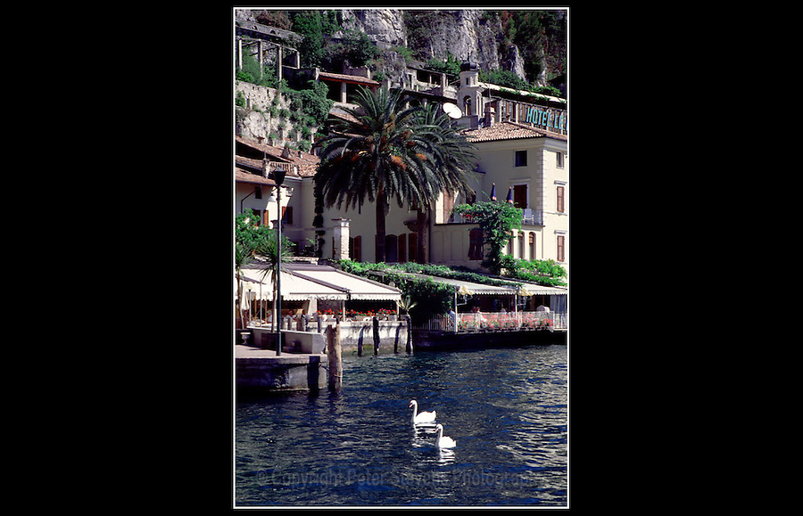 Limone sul Garda, Italy - June 1997<br /> <br /> Limone sul Garda is a town in the province of Brescia, in Lombardy (Northern Italy) on the shore of Lake Garda. Surrounded by mountains and water the economy was originally based on fishing, olives and lemons. Now the town is supported by tourism.