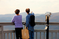 Visitors to The Blowing Rock experience a travel attraction overhanging Johns River Gorge. The immense cliff, which stands 4,000 feet above sea level, got its name because the rocky walls of the gorge form a flume that sweeps up the northwest winds with such force that it returns light objects thrown into the void.