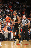 Wake Forest guard Codi Miller-McIntyre (0) handles the ball during the game against Virginia Wednesday Jan. 08, 2014 in Charlottesville, Va. Virginia defeated Wake Forest 74-51.