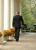 Washington, D.C. - October 11, 2006 -- United States President George W. Bush walks back to the Oval Office following a press conference in the Rose Garden at the White House in Washington, D.C. on Wednesday, October 11, 2006.  The President was asked questions on the economy, Iraq, North Korea's nuclear test, and the Foley scandal.<br /> Credit: Ron Sachs / CNP