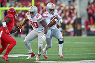 College Park, MD - NOV 12, 2016: Ohio State Buckeyes quarterback J.T. Barrett (16) runs the ball and follows his blocker Ohio State Buckeyes wide receiver Noah Brown (80) during game between Maryland and Ohio State at Capital One Field at Maryland Stadium in College Park, MD. (Photo by Phil Peters/Media Images International)