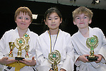 Sean Black, Lynn Victory and Ethan Martin with their trophies at the Karate Presentation in the Barbican, William Street...Photo NEWSFILE/Jenny Matthews.(Photo credit should read Jenny Matthews/NEWSFILE)....This Picture has been sent you under the condtions enclosed by:.Newsfile Ltd..The Studio,.Millmount Abbey,.Drogheda,.Co Meath..Ireland..Tel: +353(0)41-9871240.Fax: +353(0)41-9871260.GSM: +353(0)86-2500958.email: pictures@newsfile.ie.www.newsfile.ie.FTP: 193.120.102.198.