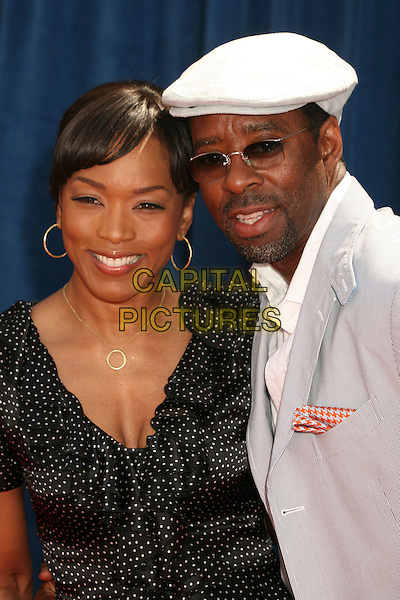 "ANGELA BASSETT & COURTNEY B. VANCE.""Meet The Robinsons"" Los Angeles Premiere at the El Capitan Theatre, Hollywood, California, USA..March 25th, 2007.headshot portrait sunglasses shades white hat hoop earrings.CAP/ADM/BP.©Byron Purvis/AdMedia/Capital Pictures"