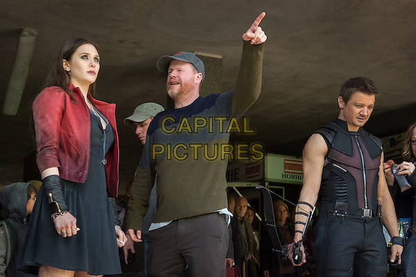 Elizabeth Olsen, Director Joss Whedon and Jeremy Renner <br /> on the set of Avengers: Age of Ultron (2015) <br /> *Filmstill - Editorial Use Only*<br /> CAP/NFS<br /> Image supplied by Capital Pictures