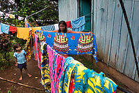 Wounaan girl hanging laundry. Jaque, Panama.