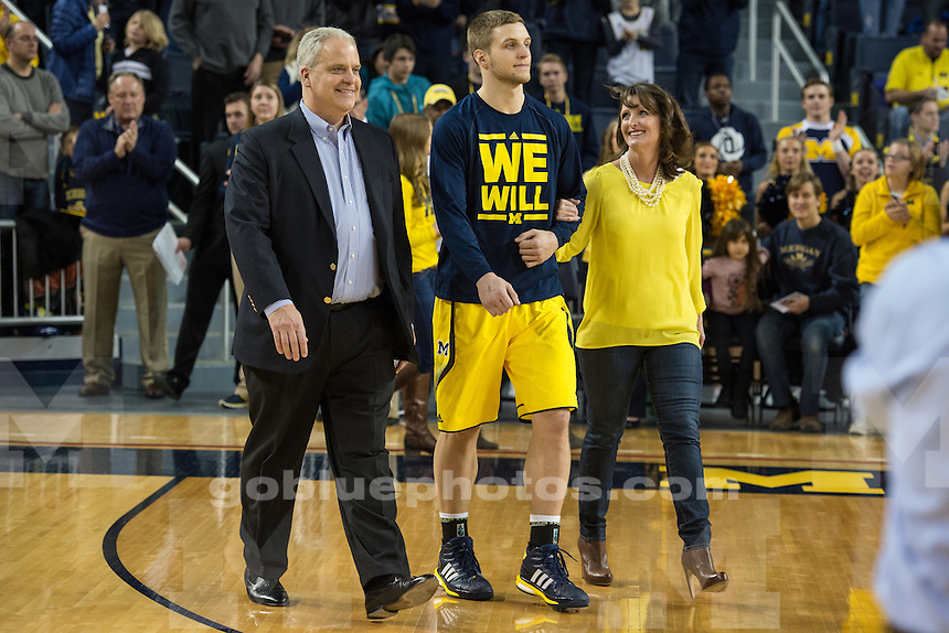 The University of Michigan men's basketball team beats Rutgers, 79-69, at Crisler Arena in Ann Arbor on March 7, 2015.