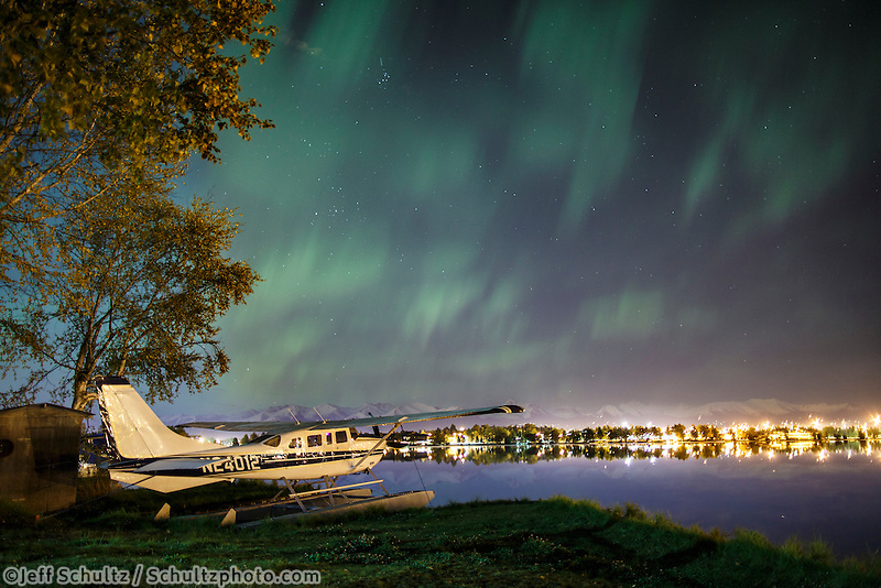 Northern Lights (Aurora Borealis) light up the sky over  Anchorage, Alaska .  Lake Hood and float plane  September 2015
