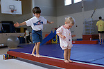 Albany, CA Boy and girl exercising on balance beam at gymnastics program for preschool children  MR