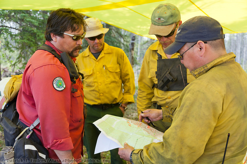 Operations team discusses strategy of the Eagle Trail forest fire near Tok, Alaska, May, 2010.