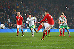 Simon Church of Wales scores his sides first goal from the penalty spot during the international friendly match at the Cardiff City Stadium. Photo credit should read: Philip Oldham/Sportimage