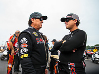 Aug 19, 2018; Brainerd, MN, USA; NHRA top fuel driver Billy Torrence (left) with son Steve Torrence during the Lucas Oil Nationals at Brainerd International Raceway. Mandatory Credit: Mark J. Rebilas-USA TODAY Sports