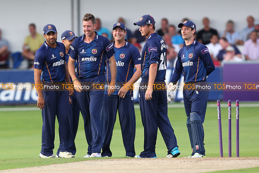 David Masters of Essex (2nd L) celebrates the wicket of Chris Nash with his team mates - Essex Eagles vs Sussex Sharks - NatWest T20 Blast Cricket at the Essex County Ground, Chelmsford, Essex - 25/07/14 - MANDATORY CREDIT: Gavin Ellis/TGSPHOTO - Self billing applies where appropriate - contact@tgsphoto.co.uk - NO UNPAID USE
