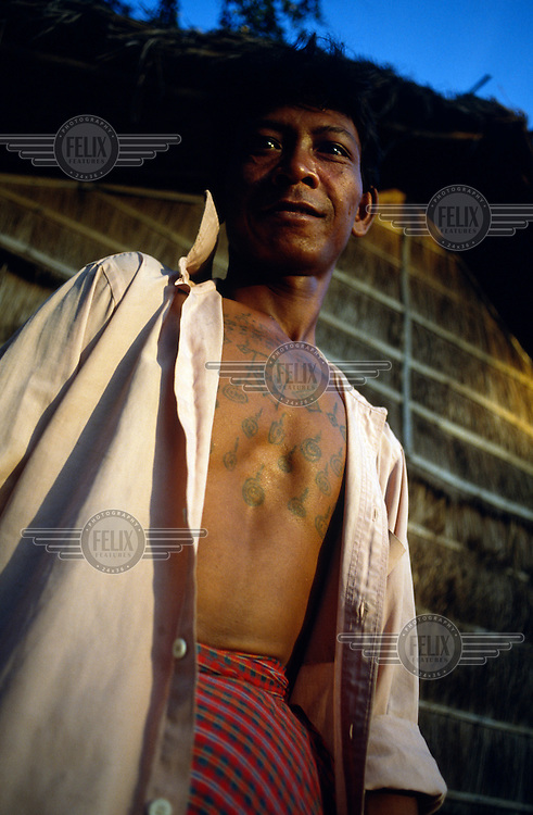 Peasant with religious tattoos that he believes will protect him from landmines.