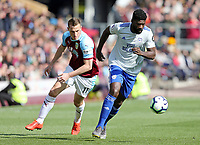 Cardiff City's Bruno Ecuele Manga under pressure from Burnley's Chris Wood<br /> <br /> Photographer Rich Linley/CameraSport<br /> <br /> The Premier League - Saturday 13th April 2019 - Burnley v Cardiff City - Turf Moor - Burnley<br /> <br /> World Copyright © 2019 CameraSport. All rights reserved. 43 Linden Ave. Countesthorpe. Leicester. England. LE8 5PG - Tel: +44 (0) 116 277 4147 - admin@camerasport.com - www.camerasport.com