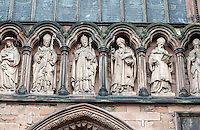 Lichfield Cathedral exterior south entrance six of a seven statue frieze of influential theologians in early Christianity (named)