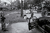 New Orleans, Louisiana.USA.July 29, 2006..The National Guard returns and patrols the streets of New Orleans after a wave of killings and people move back to the city following hurricane Katrina nearly one year ago. Three Mexicans are suspected of stealing copper wiring from a home but are later found to have been authorized to do this by the owner...