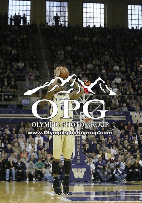 02 January 2010:  Washington Huskies guard #2 Isaiah Thomas shoots a first half three pointer against Oregon.  Oregon won 90-79 over Washington at the Bank of America Arena in Seattle, WA.