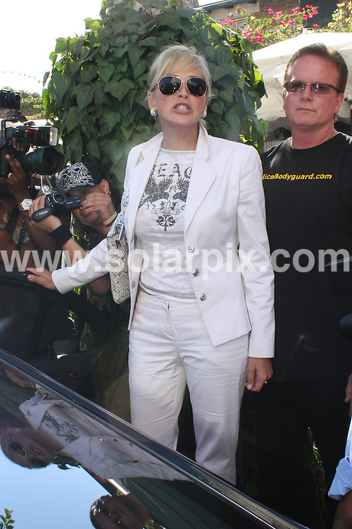 **ALL ROUND PICTURES FROM SOLARPIX.COM**.**WORLDWIDE SYNDICATION RIGHTS**.**NO PUBLICATION IN AUSTRALIA, NEW ZEALAND, DENMARK, GERMANY OR USA**.The Hollywood actress Sharon Stone has a late lunch with friends at The Ivy in Beverly Hills Los Angeles California in the USA..JOB REF:7393-LAP/HD       DATE: 17_09_08.**MUST CREDIT SOLARPIX.COM OR DOUBLE FEE WILL BE CHARGED* *UNDER NO CIRCUMSTANCES IS THIS IMAGE TO BE REPRODUCED FOR ANY ONLINE EDITION WITHOUT PRIOR PERMISSION*