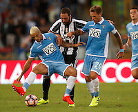Calcio, Serie A: Lazio vs Juventus. Roma, stadio Olimpico, 27 agosto 2016.<br /> Juventus&rsquo; Gonzalo Higuain, center, fights for the ball against Lazio&rsquo;s Felipe Anderson, left, and Lucas Biglia, during the Serie A soccer match between Lazio and Juventus, at Rome's Olympic stadium, 27 August 2016. Juventus won 1-0.<br /> UPDATE IMAGES PRESS/Isabella Bonotto