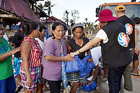 Philippines. Province Eastern Samar. Hernani. Barangay (neighbourhood) Batang. Philippine Charity Sweepstakes Office (PCSO) distributes food and non food items to the polulation. 95 % of the town was destroyed by typhoon Haiyan's winds and storm surge. Typhoon Haiyan, known as Typhoon Yolanda in the Philippines, was an exceptionally powerful tropical cyclone that devastated the Philippines. Haiyan is also the strongest storm recorded at landfall in terms of wind speed. Typhoon Haiyan's casualties and destructions occured during a powerful storm surge, an offshore rise of water associated with a low pressure weather system. Storm surges are caused primarily by high winds pushing on the ocean's surface. The wind causes the water to pile up higher than the ordinary sea level. 24.11.13 © 2013 Didier Ruef