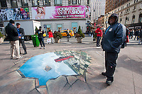 A chalk drawing on the sidewalk in Herald Square in New York is used as a promotion for General Motors' Chevrolet Sonic, seen on Friday, November 11, 2011. The company encouraged passers-by to have their photograph taken with the artwork. (© Richard B. Levine)