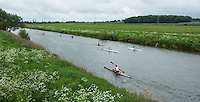 25 MAY 2014 - BRIGG, GBR - Competitors paddle their kayaks along the River Ancholme to the turn as race leader Steve King (front) heads for transition during the World Quadrathlon Federation 2014 Middle Distance World Championships at the Brigg Bomber in Brigg, Lincolnshire, Great Britain (PHOTO COPYRIGHT © 2014 NIGEL FARROW, ALL RIGHTS RESERVED)