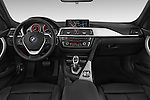 Stock photo of straight dashboard view of a 2014 BMW SERIES 3 Sport 4 Door Sedan 2WD Dashboard
