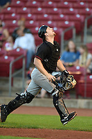 Quad Cities River Bandits catcher Brett Booth (9) tracks a foul ball pop up during a game against the Cedar Rapids Kernels on August 18, 2014 at Perfect Game Field at Veterans Memorial Stadium in Cedar Rapids, Iowa.  Cedar Rapids defeated Quad Cities 5-3.  (Mike Janes/Four Seam Images)