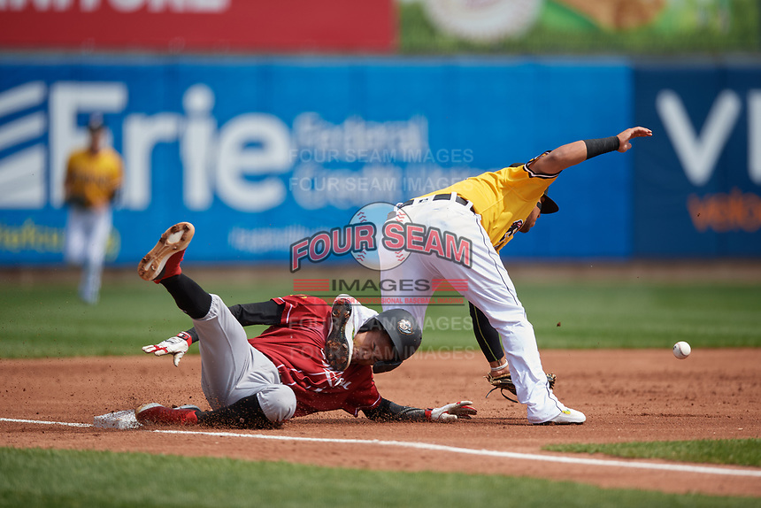 Erie SeaWolves third baseman Isaac Paredes (18) collides with base runner Alfredo Reyes (13) sliding into third base during an Eastern League game against the Altoona Curve and on June 4, 2019 at UPMC Park in Erie, Pennsylvania.  Altoona defeated Erie 3-0.  (Mike Janes/Four Seam Images)