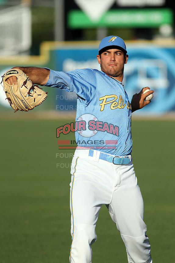 Myrtle Beach Pelicans pitcher Jimmy Reyes #13 warming up in the outfield before a game against the Frederick Keys at Tickerreturn.com Field at Pelicans Ballpark on April 24, 2012 in Myrtle Beach, South Carolina. Frederick defeated Myrtle Beach by the score of 8-3. (Robert Gurganus/Four Seam Images)