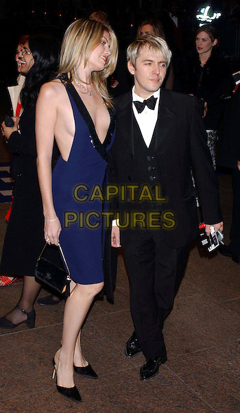 "NICK RHODES & GIRLFRIEND.Arriving At The Premiere For ""Bright Young Things"".At The Odeon Leicester Square.full length, full-length, tie, plunging neckline, revealing, cleavage.www.capitalpictures.com.sales@capitalpictures.com.©Capital Pictures"